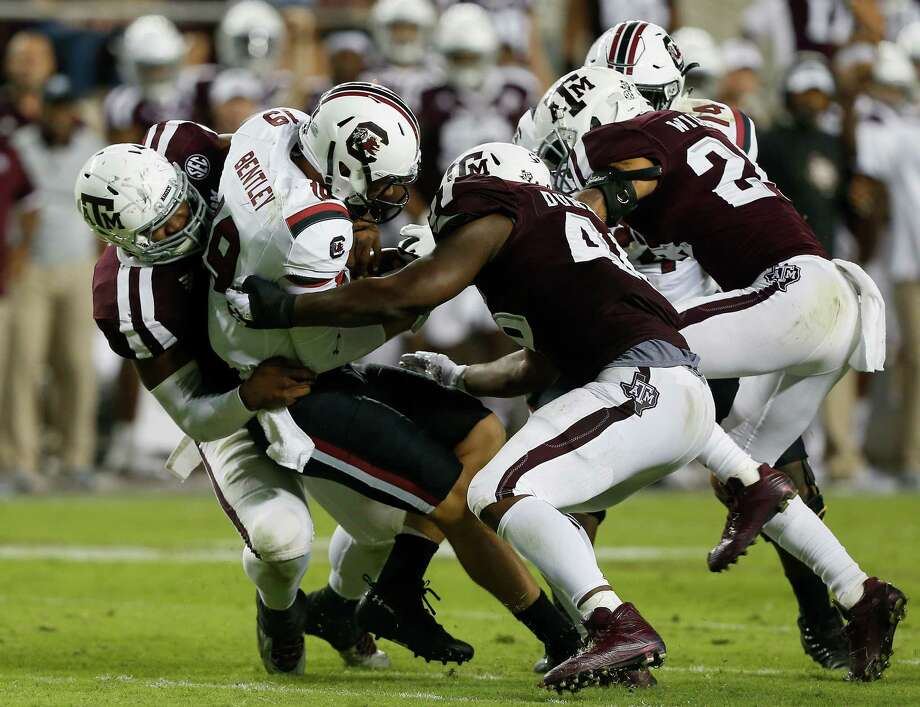 Texas A&M's Landis Durham, left, sacking Jake Bentley of South Carolina in a recent game, leads the Aggies with 51/2 sacks. Photo: Bob Levey, Stringer / 2017 Getty Images