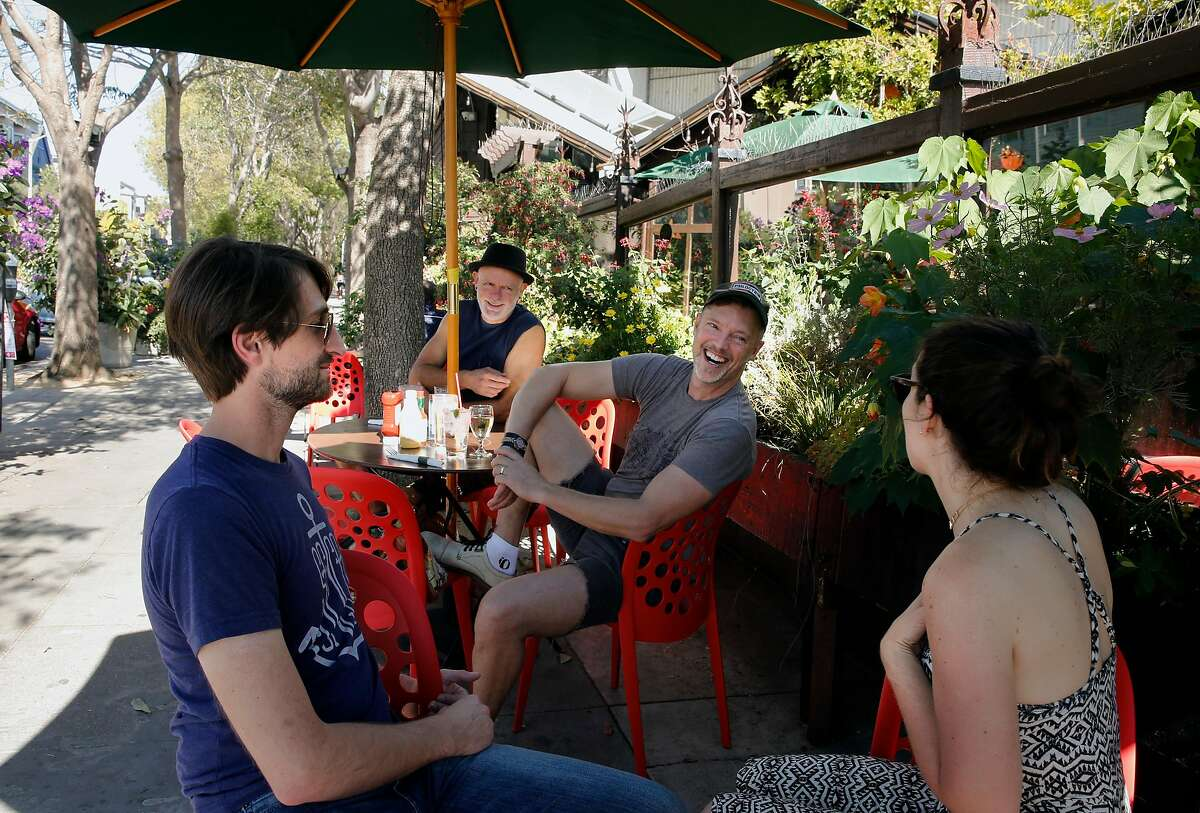 ( l to r ) Cory Krug, Mark Stevens, Birch and Stephanie Freed enjoy the sidewalk setting at Cafe Flore in San Francisco, Ca. on Thursday October 26, 2017. Owner Terrance Alan of Cafe Flore, hopes to turn the business in to San Francisco's first cannabis cafe.