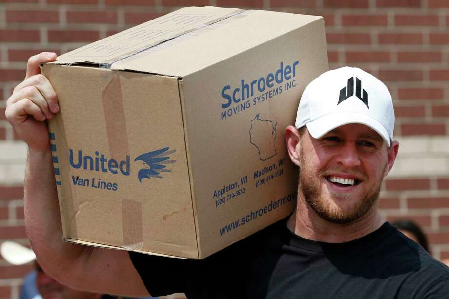 FILE - In this Sept. 3, 2017, file pool photo, Houston Texans defensive end J.J. Watt holds a box of relief supplies on his shoulder while handing them out to people impacted by Hurricane Harvey in Houston. Watt has announced plans for how the more than $37 million he raised in the wake of Hurricane Harvey will be distributed.  The Texans' defensive end will divide $30.15 million of the donations between Americares, Feeding America, SBP and Save the Children.   (Brett Coomer/Houston Chronicle via AP, Pool, File) Photo: Brett Coomer, POOL / © 2017 Houston Chronicle