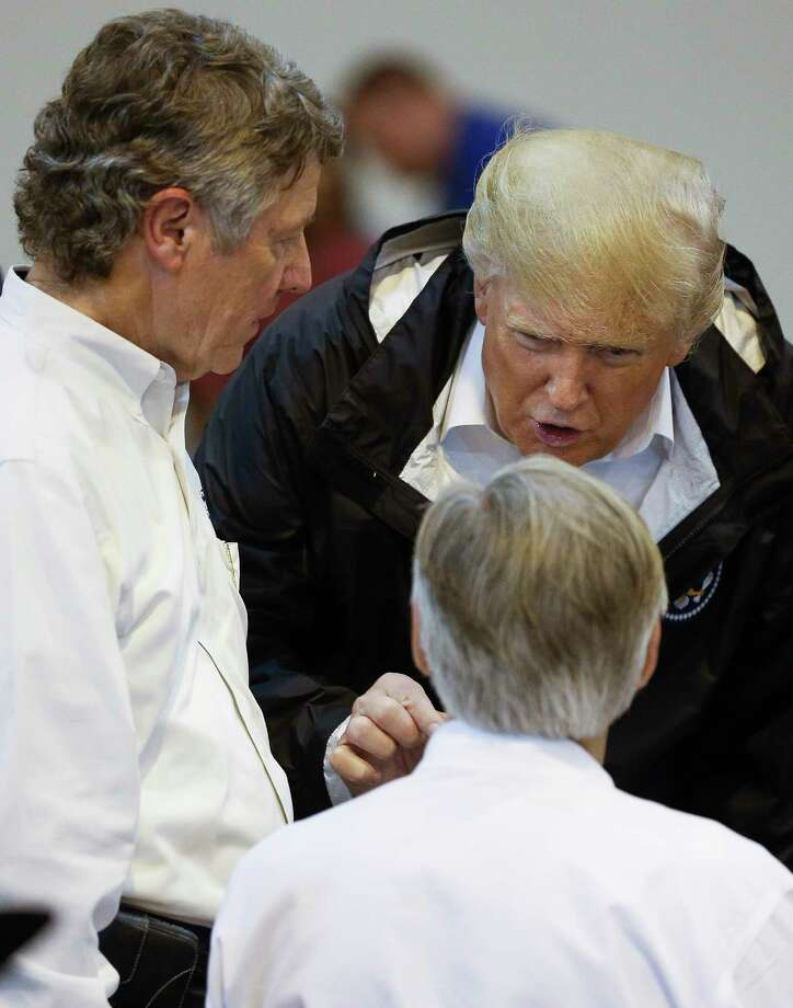 President Donald Trump, center, speaks with Harris County Judge Ed Emmett, left, and Gov. Greg Abbott while visiting Hurricane Harvey evacuees at NRG Center in Houston on Sept. 2.  ( Michael Ciaglo / Houston Chronicle) Photo: Michael Ciaglo, Houston Chronicle / Michael Ciaglo