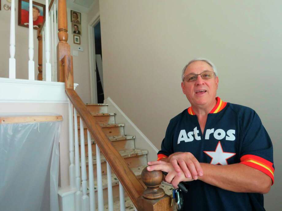 "In this Oct. 25, 2017 photo, Paul Daulong talks about how the Astros' trip to the World Series has helped him and his family focus on something positive as they continue rebuilding their Houston home after it was flooded during Hurricane Harvey. Daulong says he believes he and others who are recovering after Harvey will follow the example of the Astros, who went through their own recent rebuilding process after several losing seasons, and ""be back on top too."" (AP Photo/Juan Lozano) Photo: Juan Lozano, STF / Copyright 2017 The Associated Press. All rights reserved."