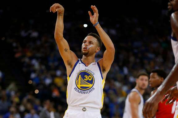 Golden State Warriors guard Stephen Curry (30) makes both of his free throws during the first half of an NBA game between the Golden State Warriors and Toronto Raptors at Oracle Arena on Wednesday, Oct. 25, 2017, in Oakland, Calif. The Warriors won 117-112.