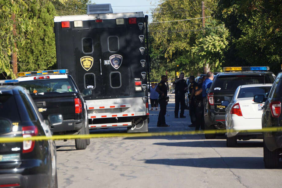 San Antonio Police officers at the scene of a shooting involving police on the 700 block of Briggs Ave. in southwest San Antonio on Thursday, Oct. 26, 2017 Photo: Jacob Beltran‏/Express-News