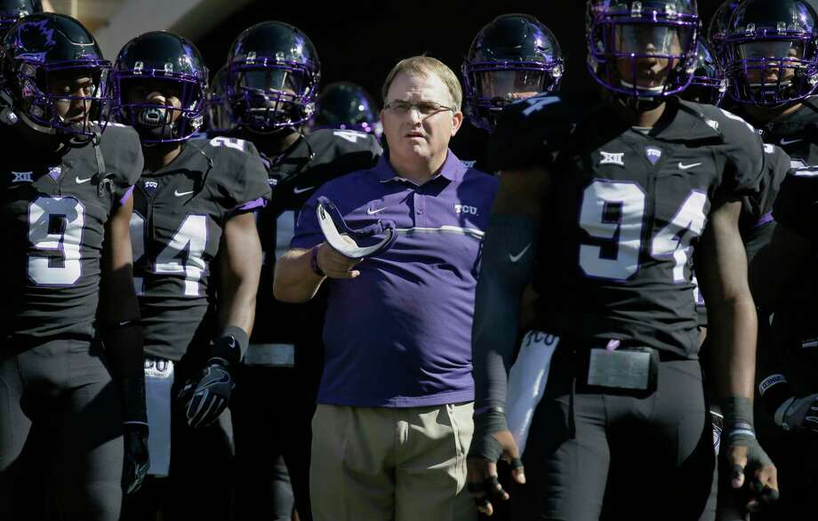 FILE - In this Oct. 1, 2016, file photo, TCU head coach Gary Patterson, center, stands with his players before an NCAA college football game against Oklahoma in Fort Worth, Texas. The Big 12 Conference has reached the midpoint of conference play with a tight race behind fourth-ranked TCU. While the Horned Frogs are the league's only undefeated team, there is a four-way tie for second place among Top 25 teams. (AP Photo/LM Otero, File) Photo: LM Otero, STF / Copyright 2017 The Associated Press. All rights reserved.