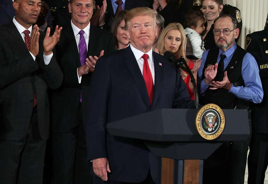 President Donald Trump declares the opioid crisis a national public health emergency in a White House announcement. Photo: Alex Wong, Getty Images