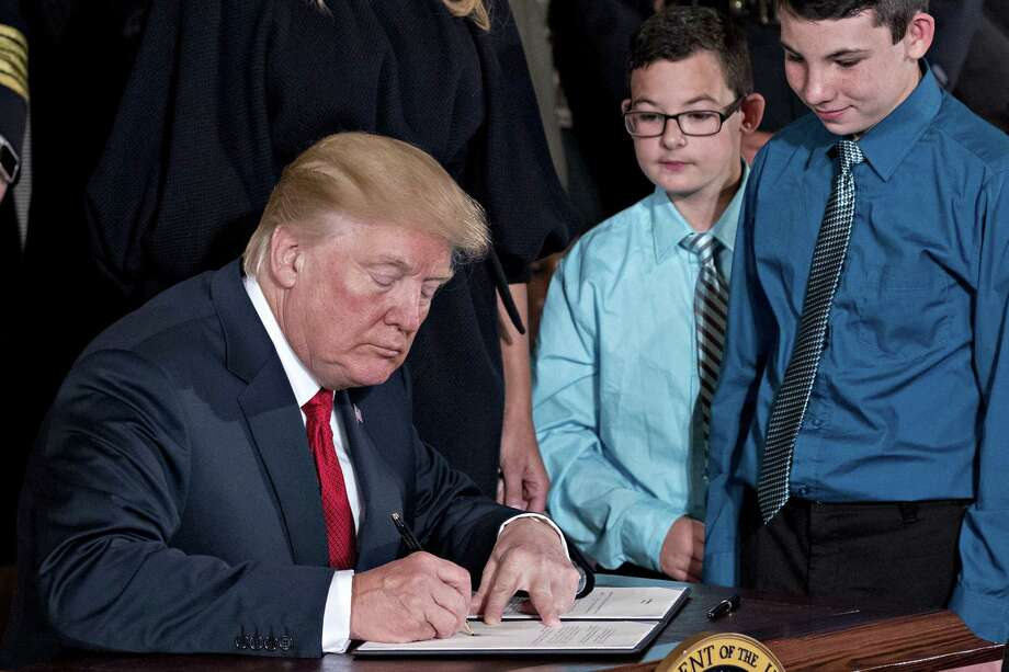 U.S. President Donald Trump signs a presidential memorandum after delivering remarks on combatting drug demand and the opioid crisis in the East Room of the White House in Washington, D.C., U.S., on Thursday, Oct. 26, 2017. Trump is instructing his administration to declare the opioid epidemic a public health emergency, a move could pave the way for a stronger federal response, allowing expanded access to telemedicine services and making grants available to those locked out of jobs because of the crisis. Photographer: Andrew Harrer/Bloomberg Photo: Andrew Harrer / © 2017 Bloomberg Finance LP
