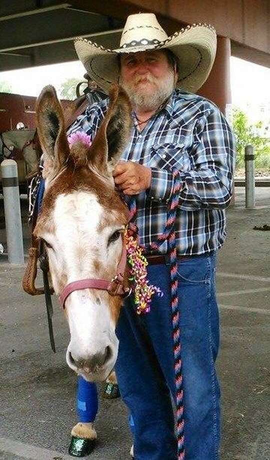 """Charles L. """"Charlie"""" Scott and his mule, Herbie, also participated in the Battle of Flowers parade every year. Photo: Courtesy Photo"""