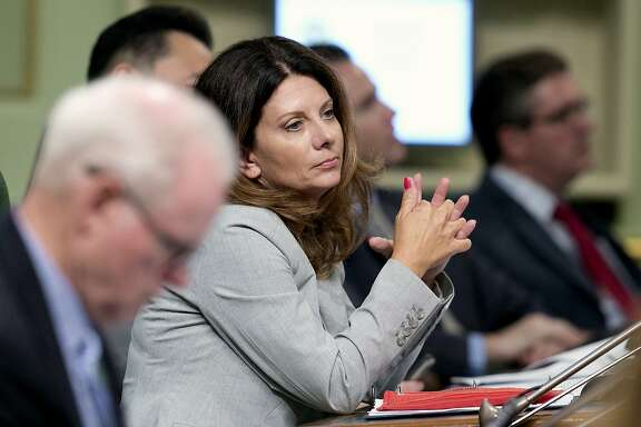FILE - In this Aug. 21, 2017, file photo, Assemblywoman Melissa Melendez, R-Lake Elsinore, sits at the Capitol in Sacramento, Calif. For four years in a row, Melendez has authored a bill to enshrine whistleblower protections into law for those legislative staff members who come forward with allegations of sexual assault and harassment, only to have the bills killed in the Senate Appropriations Committee. (AP Photo/Rich Pedroncelli, file)
