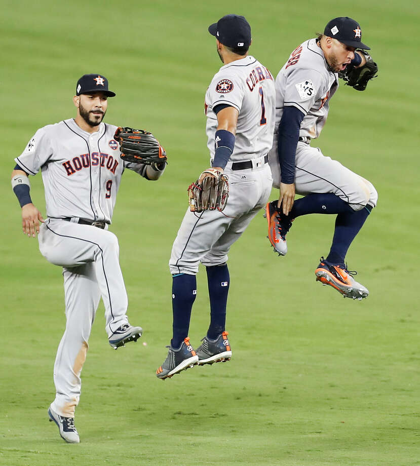 Marwin Gonzalez, left, Carlos Correa and George Springer take flight after a Game 2 win in which they all homered for the Astros. Photo: Brett Coomer, Staff / © 2017 Houston Chronicle
