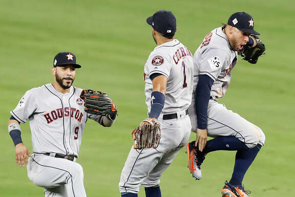 Marwin Gonzalez, left, Carlos Correa and George Springer take flight after a Game 2 win in which they all homered for the Astros.