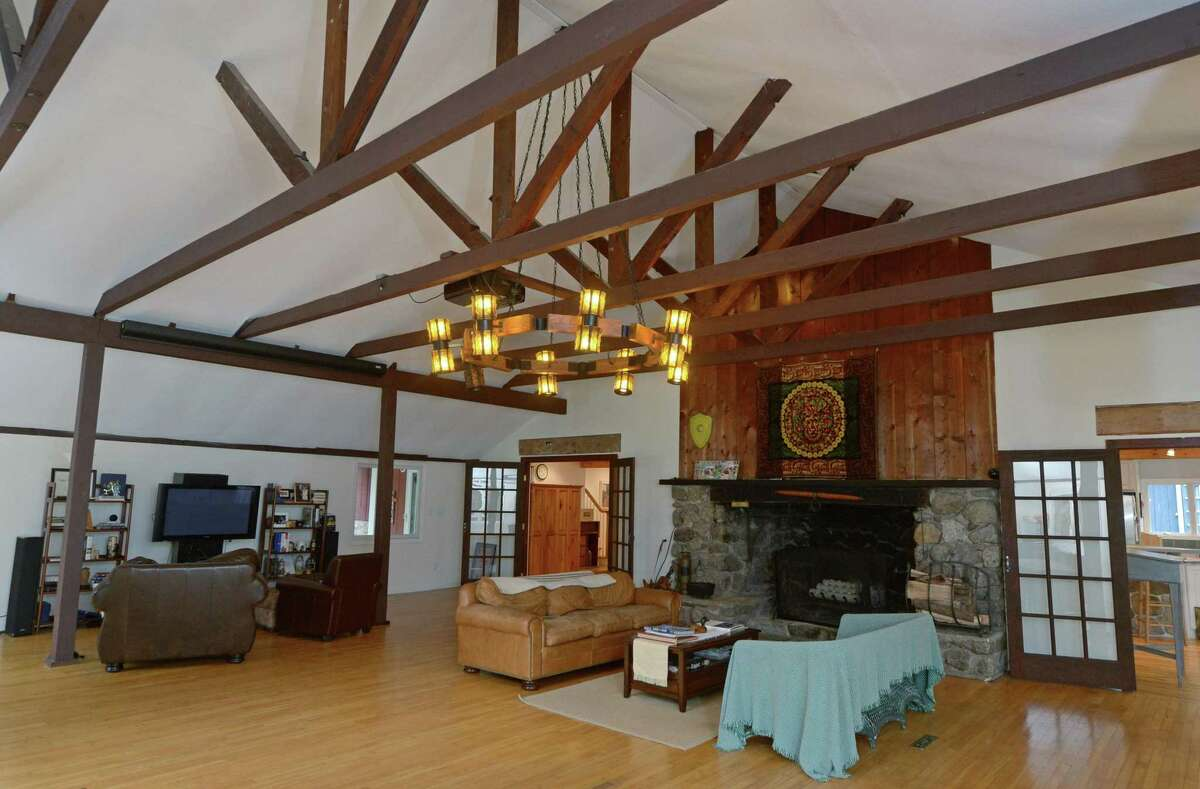 The main living area in the main house at 808 Ridgefield Road, Tuesday, October 24, 2017, once served as the dining hall for a girls riding camp at the beginning of the twentieth century and now is part of a single family home that is on the market in Wilton, Conn. Four of the five cabins behind the main house that once served as bunkhouses for the camp are still in good condition and have been turned into everything from a greenhouse, to a kids playroom, to an indoor hot tub.