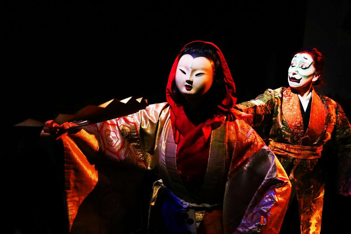 """The Ghost of Christmas Present (Adrian Deane) leads Sukurooji (Shannon Davis) through time and space in Theatre of Yugen's """"A Noh Christmas Carol."""""""