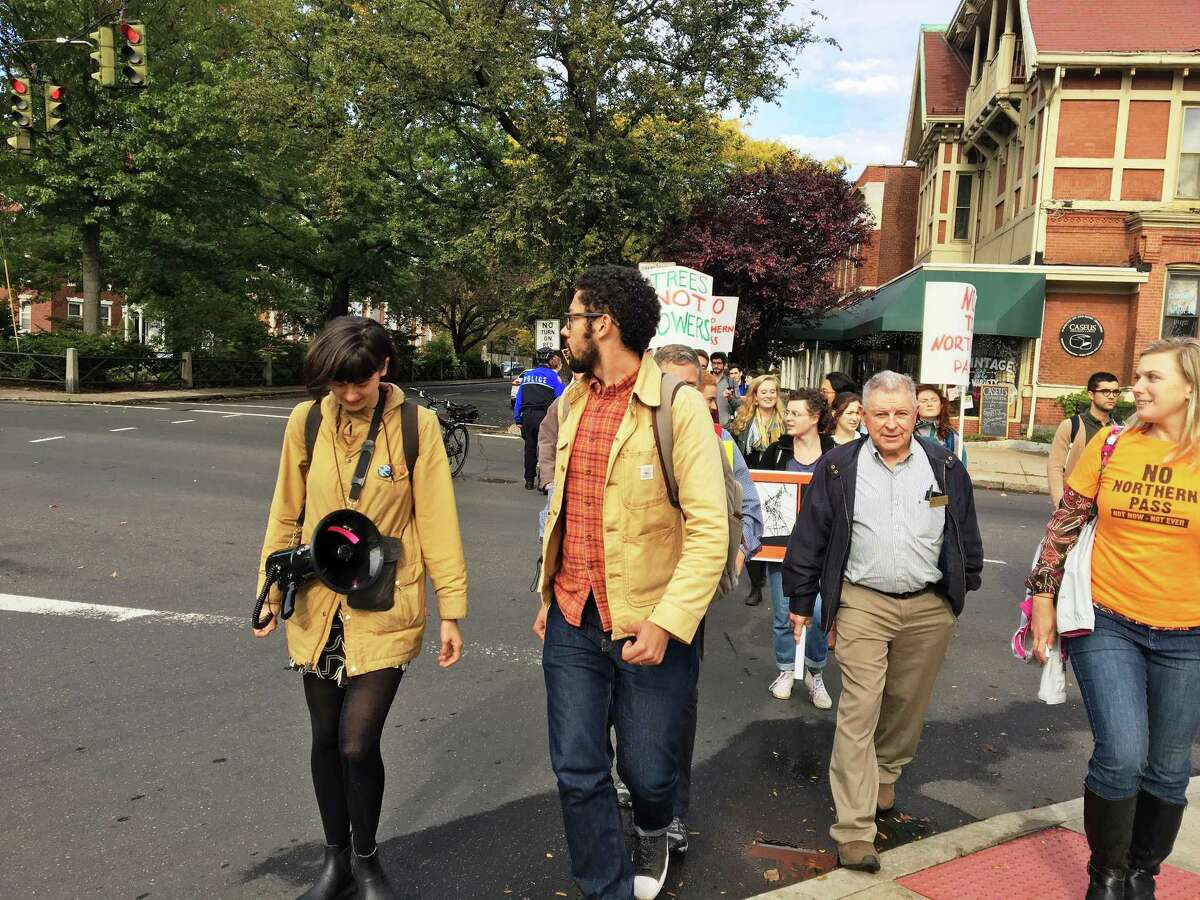 Students and a contingent from New Hampshire marched to Yale University's investment office Thursday to protest its connection to the Northern Pass transmission line project that they said will have devastating environmental and social consequences for that state.