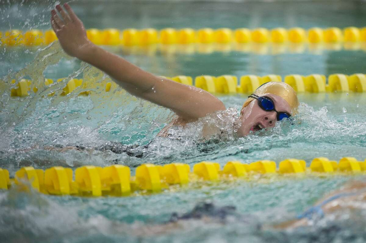 Dow freshman Mackenzie Thackery competes in the 200 yard freestyle during a swim meet against Midland on Thursday, Oct. 26, 2017 at H. H. Dow High School. (Katy Kildee/kkildee@mdn.net)