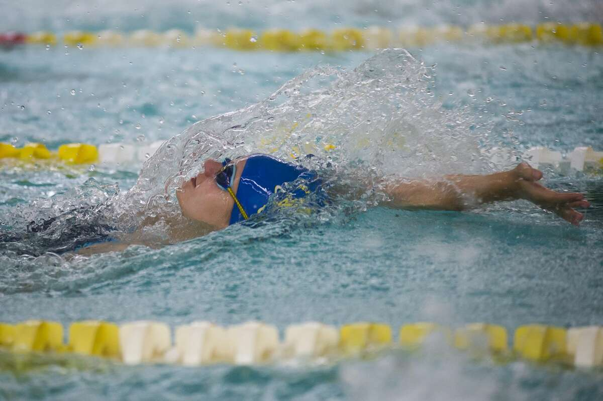 Midland senior Maddie Allen competes in the 200 yard medley relay during a swim meet against Dow on Thursday, Oct. 26, 2017 at H. H. Dow High School. (Katy Kildee/kkildee@mdn.net)
