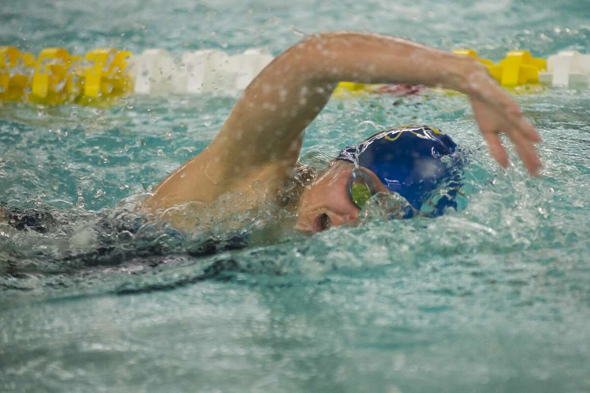 Midland junior Delaney Randall competes in the 200 yard freestyle during a swim meet against Dow on Thursday, Oct. 26, 2017 at H. H. Dow High School. (Katy Kildee/kkildee@mdn.net)