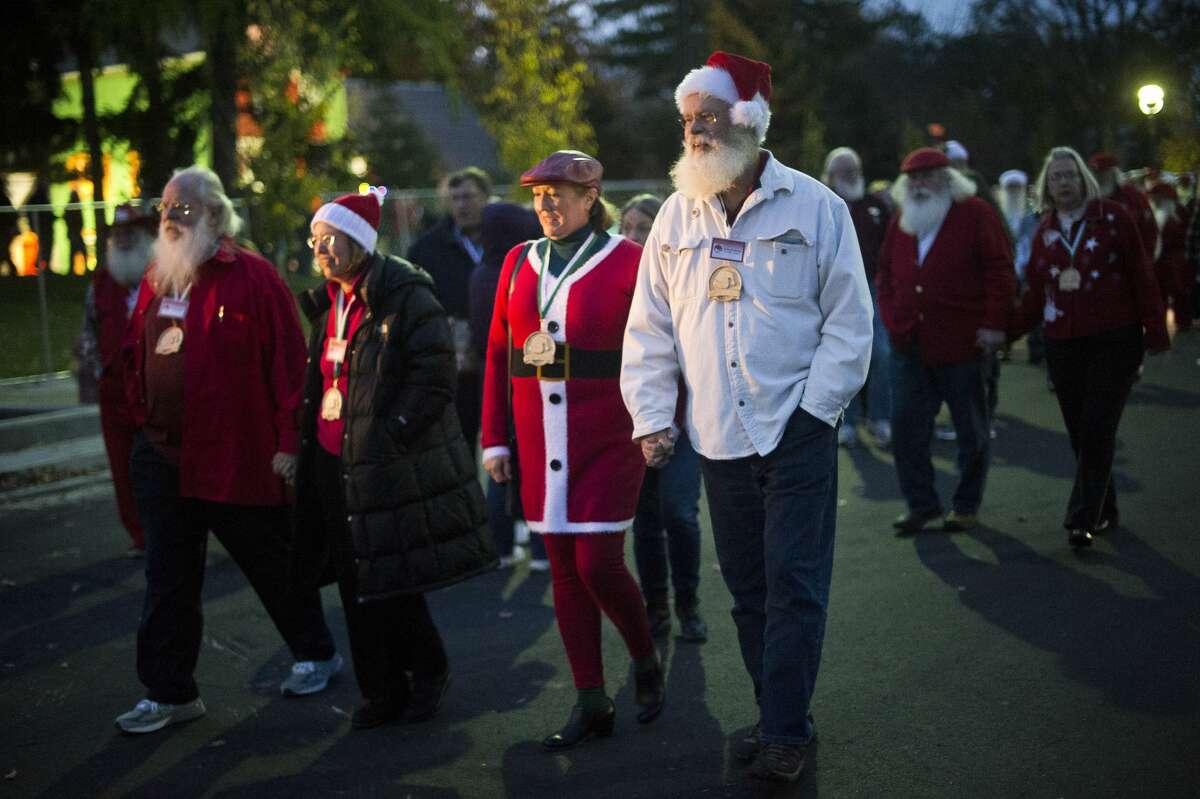 Participants in the Santa Walk stroll down Main Street on Thursday, Oct. 26, 2017. The walk is part of the annual Charles W. Howard Santa Claus School in Midland. (Katy Kildee/kkildee@mdn.net)
