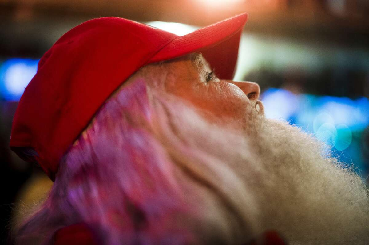 Dave Fisher of West Virginia looks up at the decorations inside the Santa House before participating in the Santa Walk on Thursday, Oct. 26, 2017, which is part of the annual Charles W. Howard Santa Claus School in Midland. (Katy Kildee/kkildee@mdn.net)