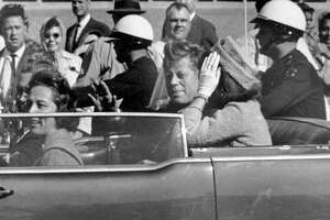 FILE - In this Nov. 22, 1963 file photo, President John F. Kennedy waves from his car in a motorcade in Dallas. Riding with Kennedy are First Lady Jacqueline Kennedy, right, Nellie Connally, second from left, and her husband, Texas Gov. John Connally, far left. The National Archives is due to release the John F. Kennedy assassination files on Thursday, Oct. 26, 2017. (AP Photo/Jim Altgens, File)