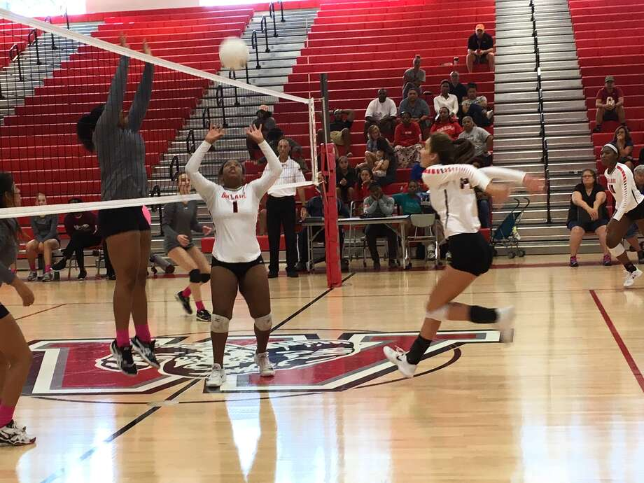 Bellaire's Chancellor Deal sets a ball for Maddie Ogden during the Cardinals' District 18-6A match against Heights as Ashley Smith defends Oct. 14 at Waltrip High School. Bellaire finished its fourth consecutive undefeated district championship. Photo: Jack Marrion