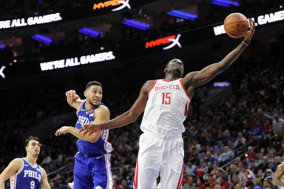 Houston Rockets' Clint Capela (15) reaches for the ball as Philadelphia 76ers' Ben Simmons defends the first half of an NBA basketball game, Wednesday, Oct. 25, 2017, in Philadelphia. The Rockets won 105-104. (AP Photo/Michael Perez) Photo: Michael Perez, FRE / FR168006 AP