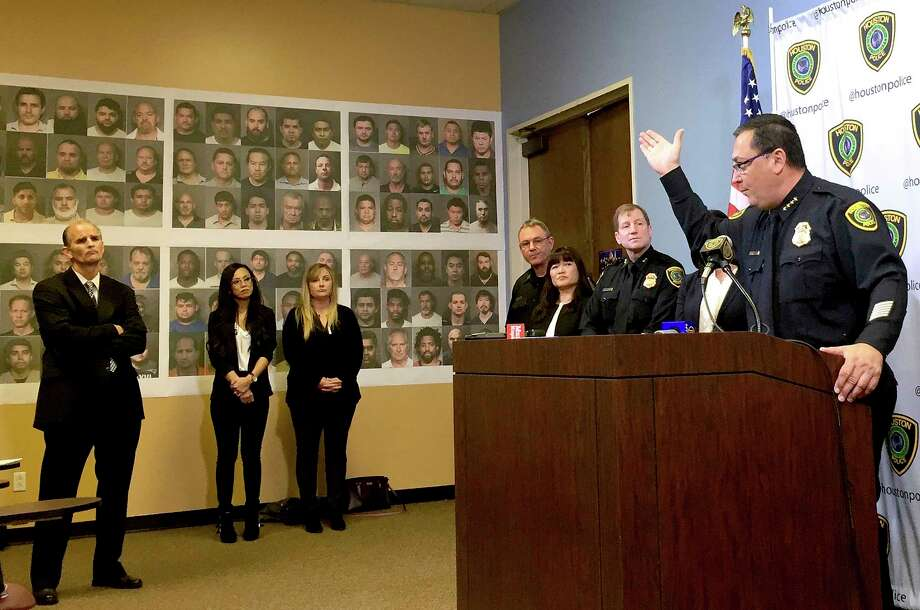 Houston Police Chief Art Acevedo addresses the media regarding 139 men, whose mugs line the wall, who were arrested in the sting. He said he hoped the publicity would discourage others. Photo: Brian Rogers, MBO / Houston Chronicle