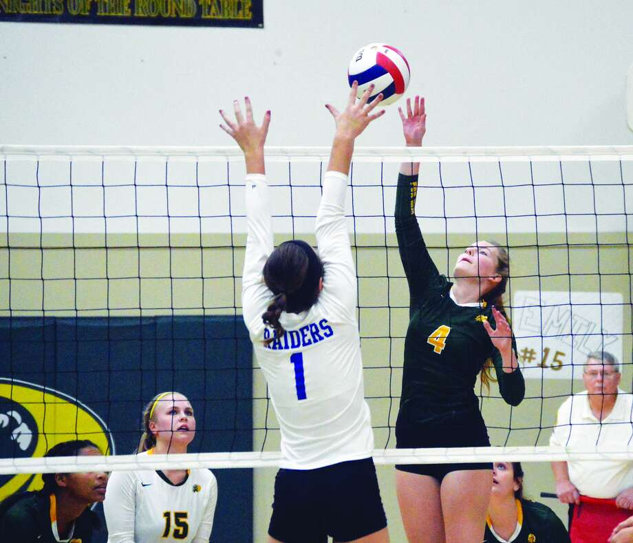 Metro-East Lutheran's Alaina Bozarth goes up for a kill during first-game action against Brussels in the Class 1A Metro-East Lutheran Regional title match.