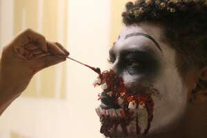 """Actor Agustin Pizano has a prosthetic applied to his face at the Fear Overload haunted house in San Leandro, California on October 25, 2017. This look later won """"makeup of the night."""""""