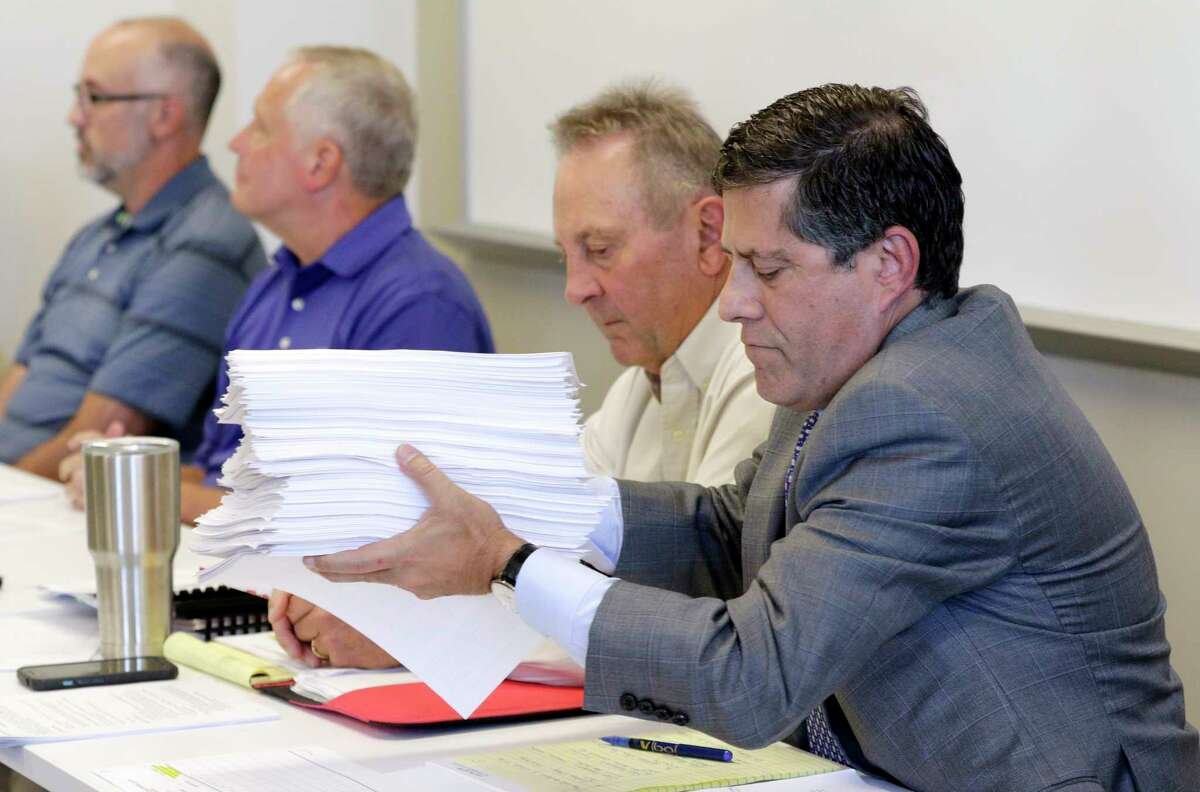 MUD 386 attorney Howard Cohen, holding petitions presented by residents attending the group's meeting Thursday, said nothing could have prevented the flooding from Hurricane Harvey.