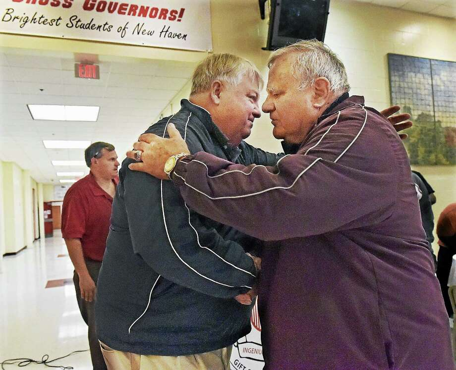 Pete Barbarito, right, head football coach at Wilbur Cross High School from 1975 to 1994 embraces Mike Marone, son of Horace Marone who served as head football coach at Wilbur Cross from 1957-1974 during a dedication ceremony naming the Barbarito/Marone Football Field in 2014. Barbarito died on Wednesday at age 77 according to his son Eric. Photo: Catherine Avalone / Journal Register Co. / New Haven RegisterThe Middletown Press