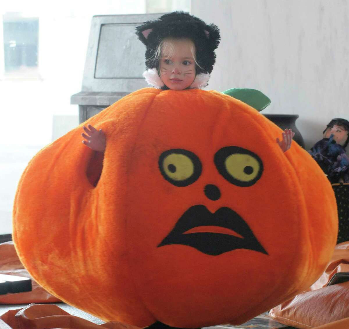 Ashley Grogan, 3 years old, dressed as a cat, tries on a giant pumpkin outfit at the New York State Museum during the museum?s 7th annual Halloween festival for kids in Albany, NY on Sunday, Oct. 24, 2010. The Museum will host another Halloween festival for kids on Saturday Oct. 30th and Sunday Oct. 31st from noon to 4pm each day, with a children's parade taking place at 1pm each day. All proceeds benefit the Museum?s after-school programs. (Paul Buckowski / Times Union)