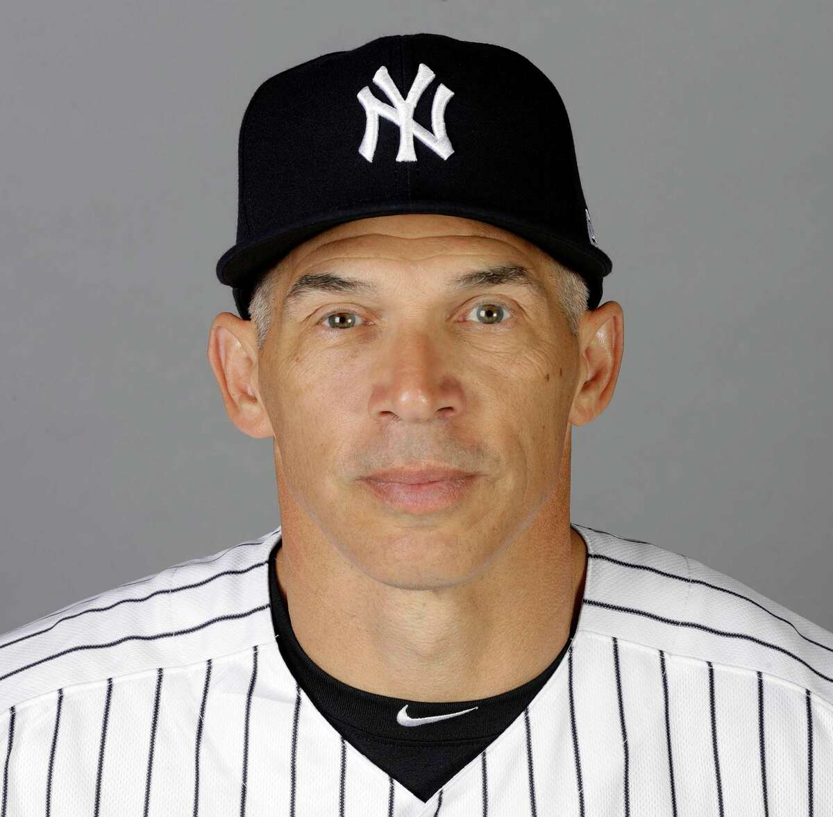 FILE - This is a Feb. 21, 2017, file photo showing New York Yankees manager Joe Girardi, in Tampa, Fla. The New York Yankees announced Thursday, Oct. 26, 2017, that Girardi will not return to the team in the 2018 season. The announcement was made by Yankees Senior Vice President and General Manager Brian Cashman. (AP Photo/Chris O'Meara, File)