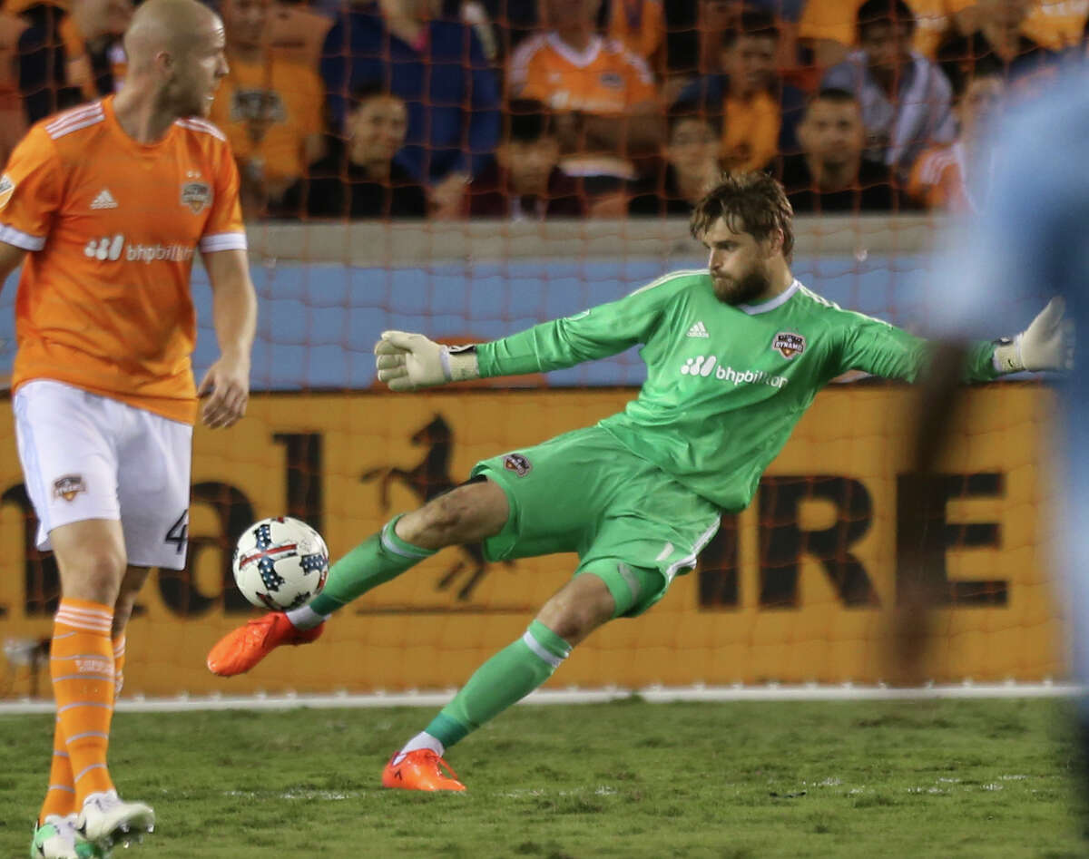 Houston Dynamo goalkeeper Tyler Deric (1) performs a goal kick during the first half of the first-round playoff MLS match against the Sporting Kansas City at BBVA Compass Stadium Thursday, Oct. 26, 2017, in Houston. ( Yi-Chin Lee / Houston Chronicle )
