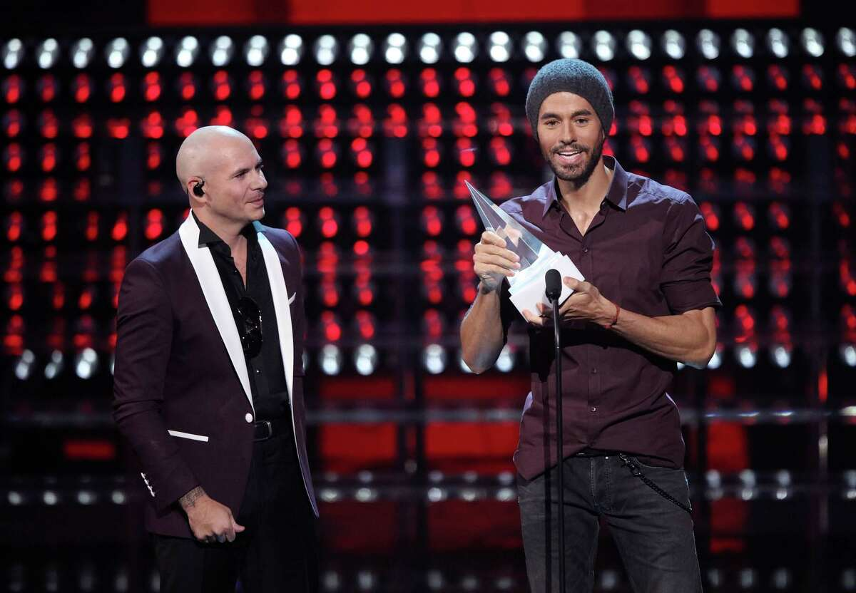 Recording artists Pitbull (L) and Enrique Iglesias onstage during the 2017 Latin American Music Awards at Dolby Theatre on October 26, 2017 in Hollywood, California.