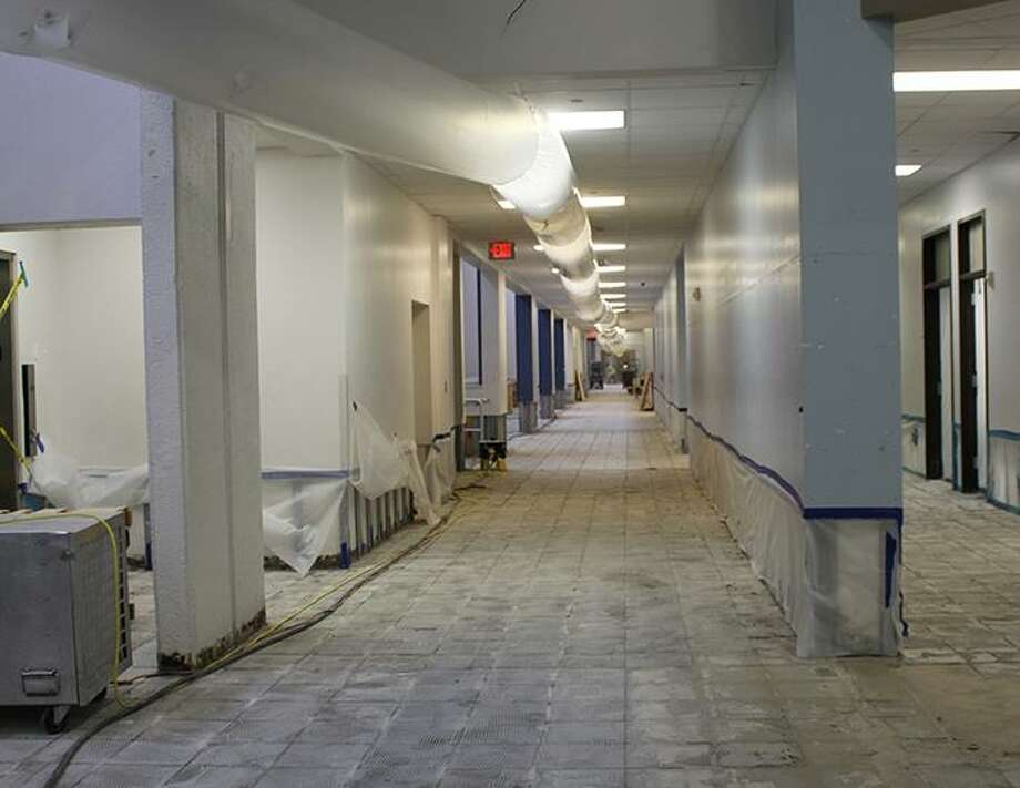 Tile has been removed in the second-floor hallway at Kingwood High School. Photo: Courtesy