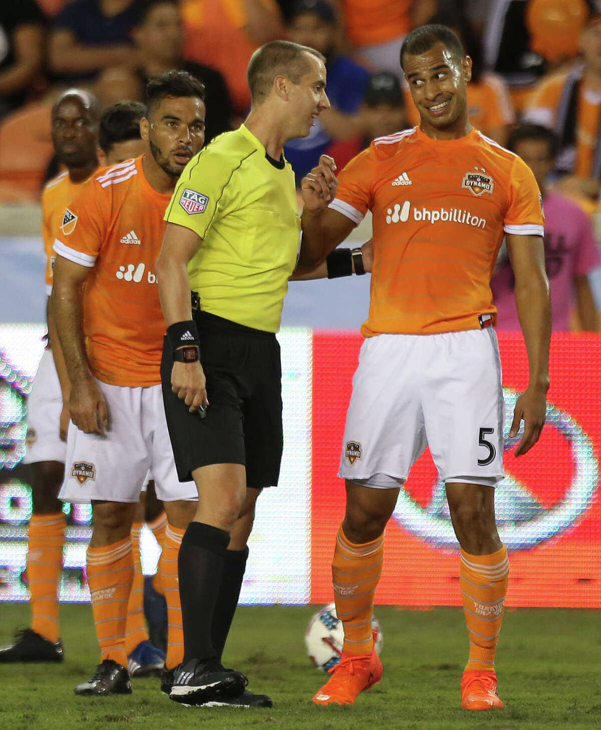 Houston Dynamo midfielder Juan David Cabezas (5) talks to Referee Mark Geiger about him calling foul against Houston Dynamo midfielder Alex (14) during the first half of the first-round playoff MLS match against the Sporting Kansas City at BBVA Compass Stadium Thursday, Oct. 26, 2017, in Houston. ( Yi-Chin Lee / Houston Chronicle )