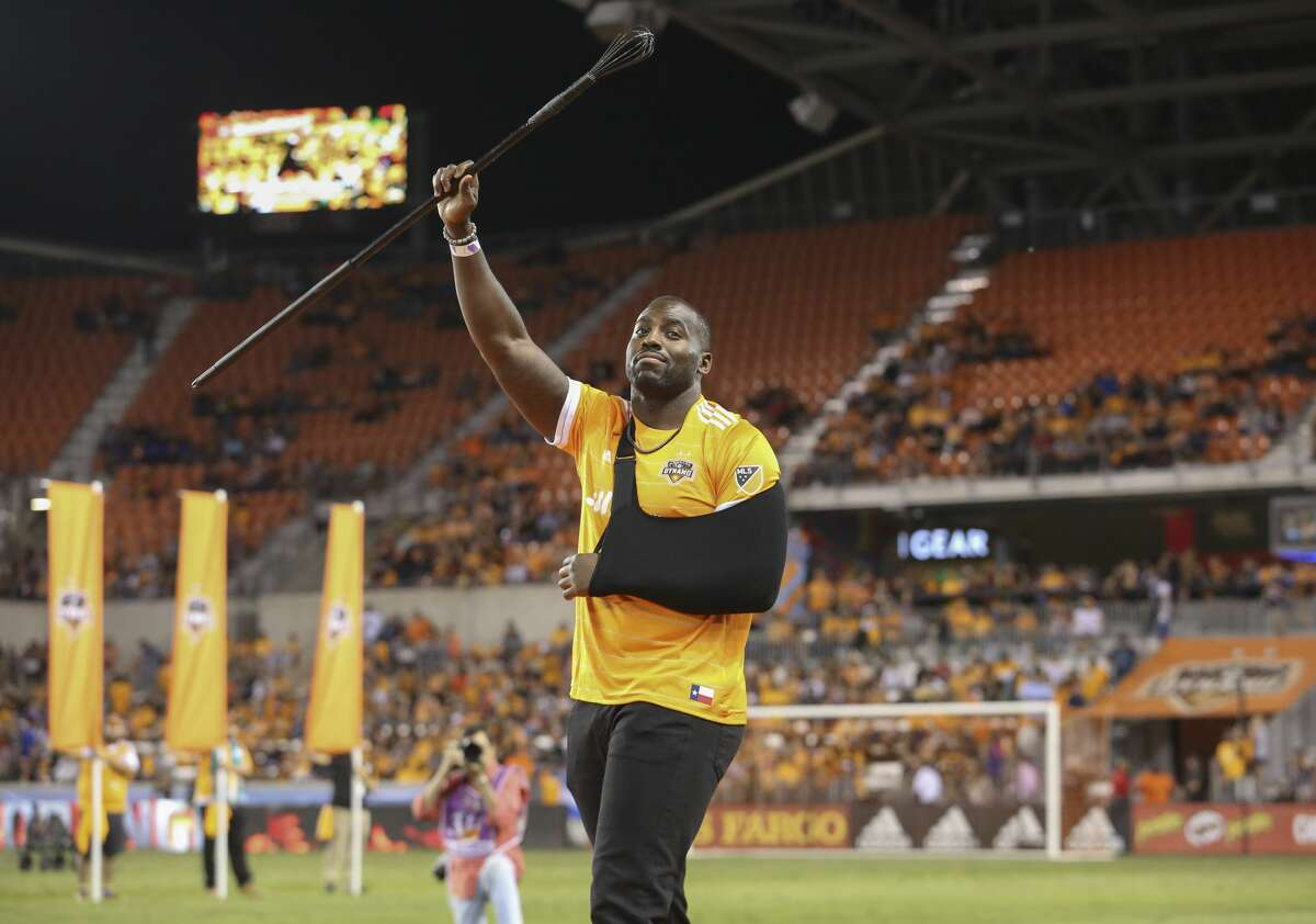 Houston Texans' Whitney Mercilus greets the audience as he is about to fire the canon for the opening ceremony of the first-round playoff MLS match between Houston Dynamo and Sporting Kansas City at BBVA Compass Stadium Thursday, Oct. 26, 2017, in Houston. ( Yi-Chin Lee / Houston Chronicle )