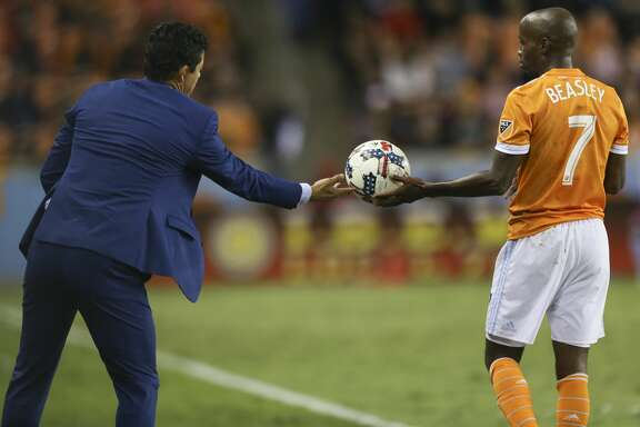 Houston Dynamo head coach Wilmer Cabrera gives the ball to  defender DaMarcus Beasley (7) from the sideline during the second half of the first-round playoff MLS match at BBVA Compass Stadium Thursday, Oct. 26, 2017, in Houston. ( Yi-Chin Lee / Houston Chronicle )