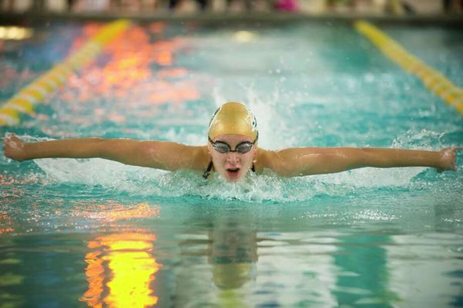 Dow sophomore Sasha Konovalenko competes in the 200-yard individual medley during Thursday's swim meet against Midland at Dow High School. Konovalenko won the event. (Katy Kildee/kkildee@mdn.net)