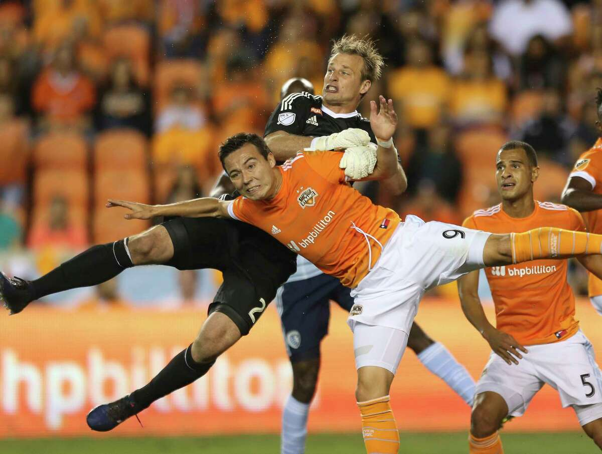 Houston Dynamo forward Erick Torres (9) and Sporting Kansas City goalkeeper Andrew Dykstra (21) collide when Torres is trying to score a goal during the first half of the first-round playoff MLS match at BBVA Compass Stadium Thursday, Oct. 26, 2017, in Houston. ( Yi-Chin Lee / Houston Chronicle )