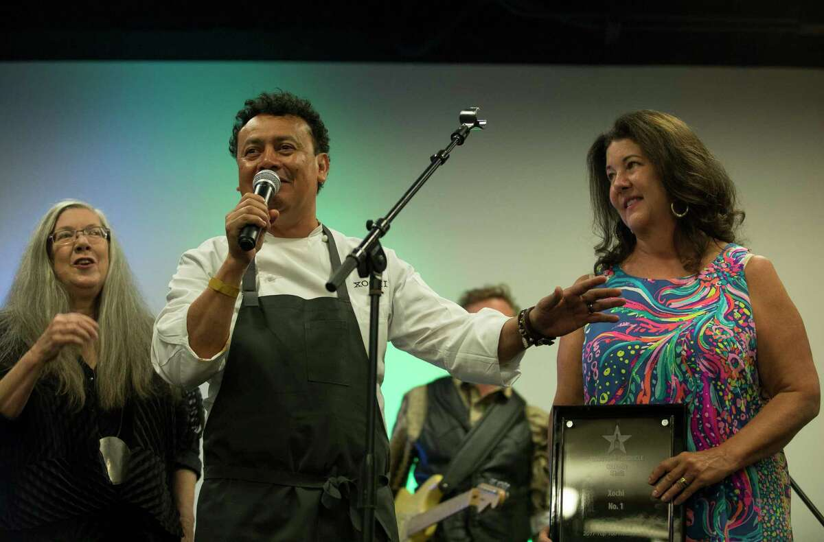 Hugo Ortega speaks to the crowd at Culinary Stars, flanked by Alison Cook, left, and Tracy Vaught.