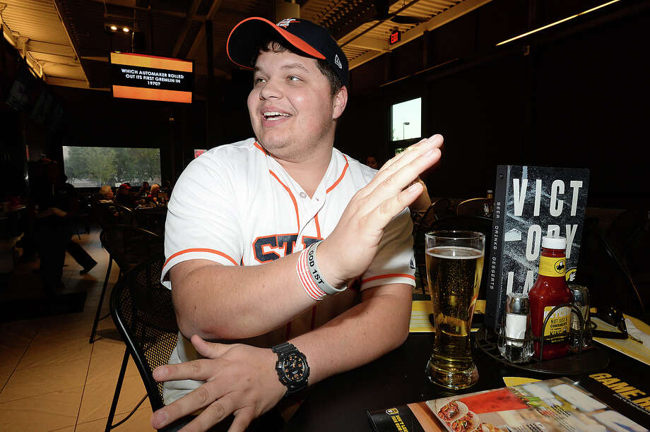 Brendan Allinder of Mauriceville hasn't taken off the wrist band he got from game 1 of the Astros' play-off run against the Yankees and says he'll be wearing it for good luck throughout the World Series. Photo taken Tuesday, October 24, 2017 Kim Brent/The Enterprise Photo: Kim Brent / BEN