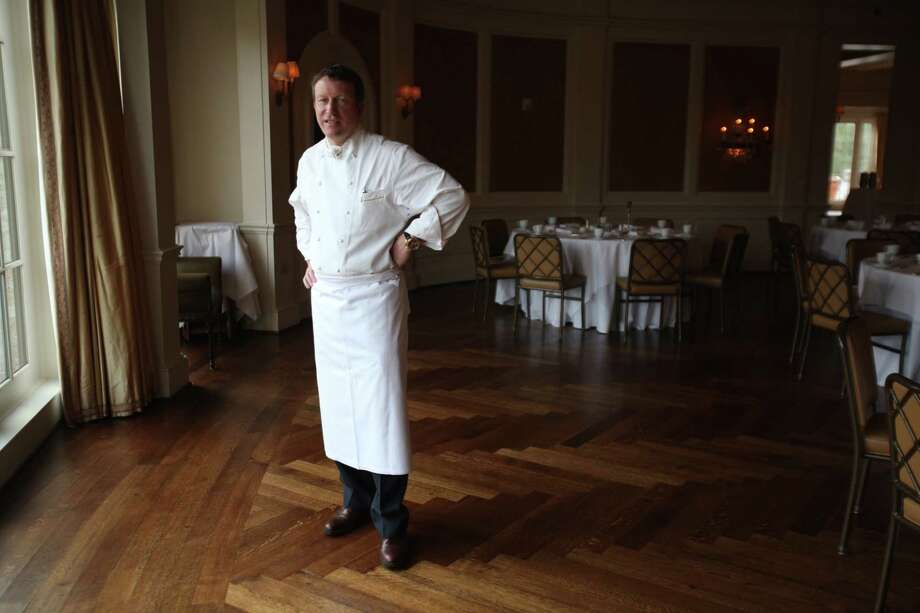 Charles Carroll, the executive chef at River Oaks Country Club, took a novel approach to sharing his passion for cooking. He wrote an actual novel. Photo: Mayra Beltran, Staff / © 2011 Houston Chronicle