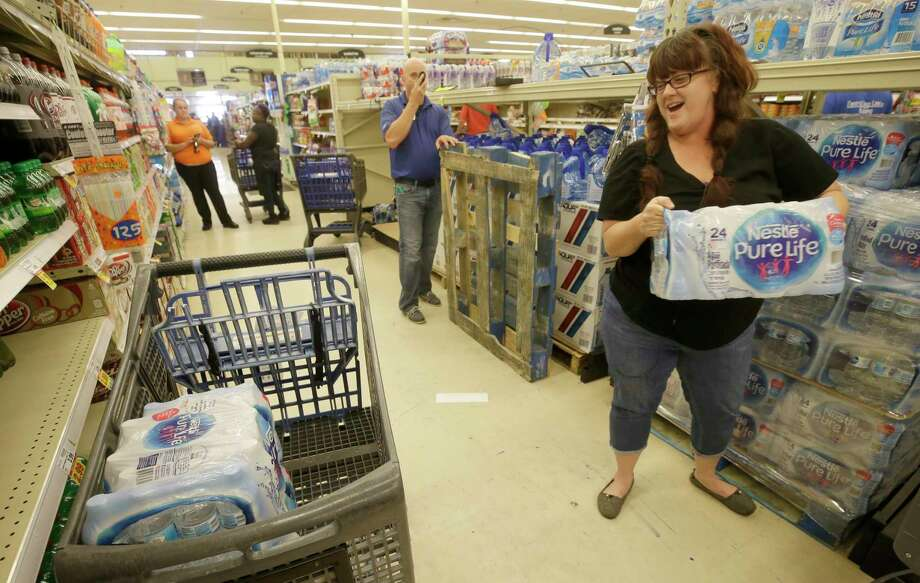 For an emergency supply stash, experts recommend stocking one gallon of water per person per day for at least three days. Photo: Melissa Phillip, Staff / © 2017 Houston Chronicle