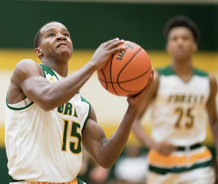 Kharee McDaniel (15) of the Klein Forest Eagles goes for a layup. McDaniel is among the key returners that are charged with spearheading the next era of Eagles basketball. Klein Forest won its third consecutive district title last year. Photo: Wilf Thorne / © 2017 Houston Chronicle
