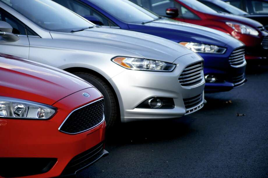 A row of 2015 Ford Fusions are for sale on the lot at Butler County Ford in Butler, Pa. A person in Georgia told the National Highway Traffic Safety Administration that a steering wheel fell into their lap in a 2015 Fusion when turning into a gas station on Sept. 23. Photo: Associated Press File Photo / Internal