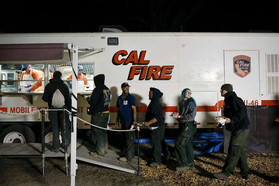 Crew members with Diamond Fire from Oregon, line up to get food after working a 16 hour day working on the fire lines, at the CalFire camp and operations center at the Sonoma County Fairgrounds in Santa Rosa, Calif, on Thursday October 12, 2017.