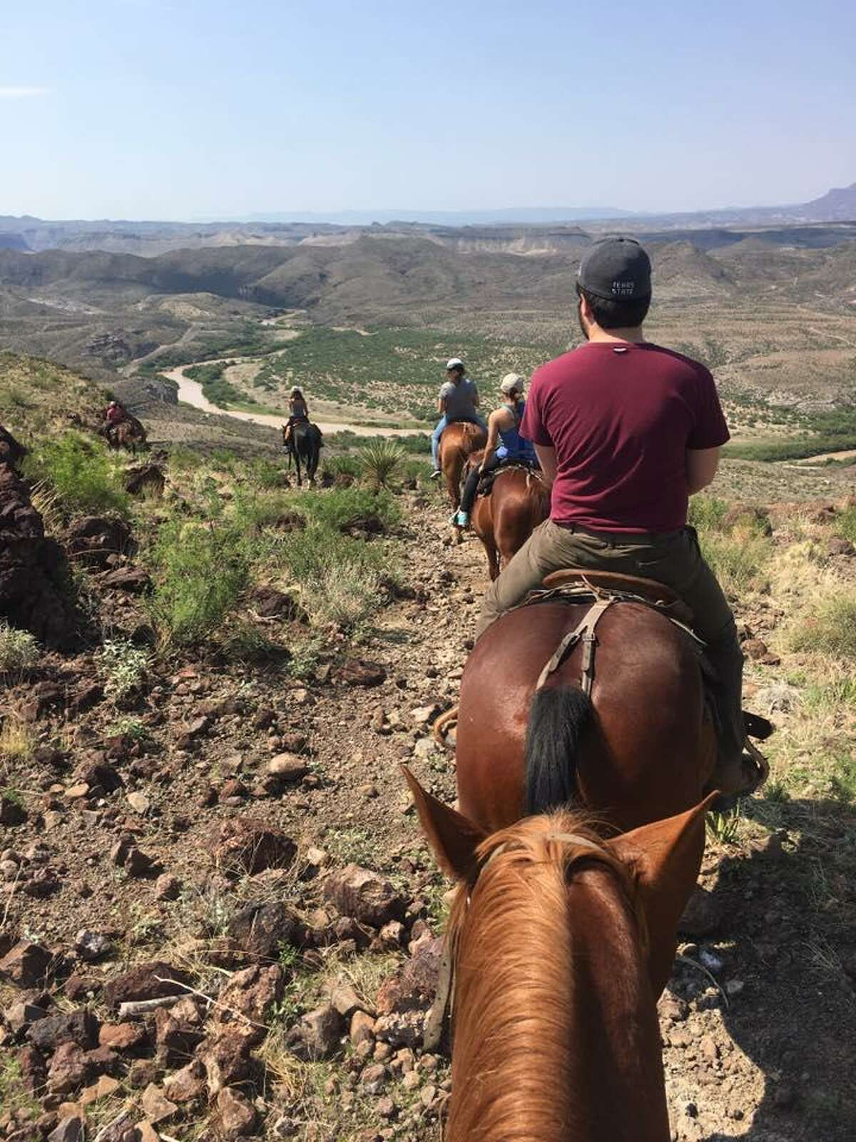 The horses rode over rocky terrain as mass communication students from Texas State University explored Big Bend Ranch State Park.