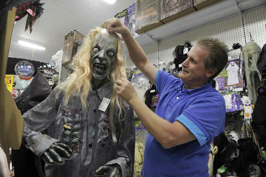 John Ruffino, manager of Party Depot on South Street in Danbury, with one of the many ghoulish Halloween figures available in the store, Wed. Oct. 25, 2017. Photo: Carol Kaliff / Hearst Connecticut Media / The News-Times