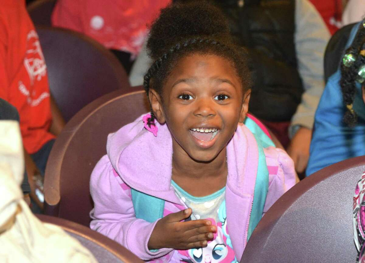 Chiya Wilson reacts to a STEM presentation during the Norwalk Housing Authority Learning Centers Lights On Afterschool celebration at Stepping Stones Museum for Children on Thursday, Oct. 26 in Norwalk.